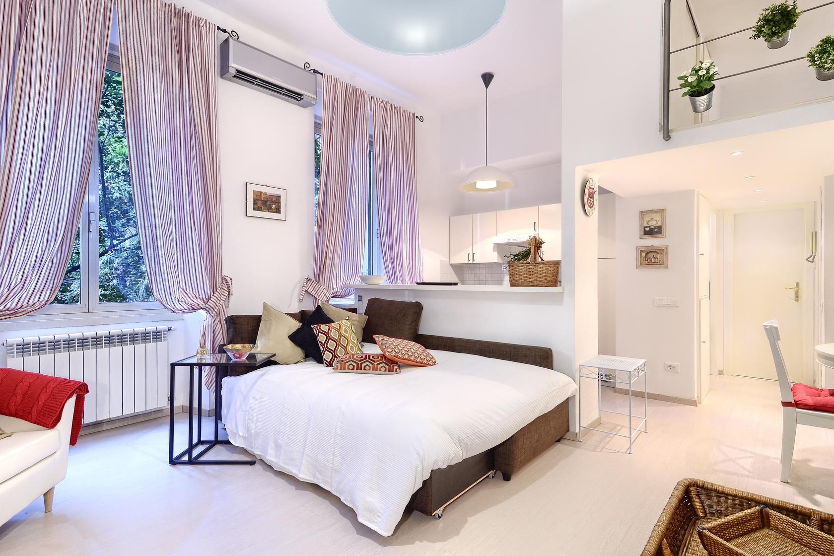 9 soggiorno con divano letto 4 - Affitti Brevi Periodi Roma